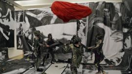 Performers take part at Turner Prize nominee Spartacus Chetwynd's performance entitled