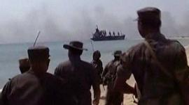 Sri Lankan military looking towards smoke from a battle