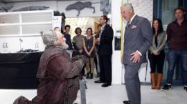 Prince Charles (R) meets with Mark Hadlow who plays the dwarf Dori (L) in the upcoming Hobbit movie during his visit to Peter Jackson
