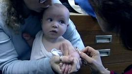 Baby having a meningitis jab
