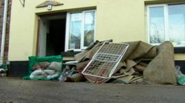 Damaged carpet and possessions outside house