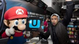 Izzy Rahman, the first person to buy a new Wii U console from the HMV store on London's Oxford Street