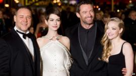 Russell Crowe (L) Anne Hathaway (2-L) Hugh Jackman (2-R) and Amanda Seyfried (R) pose for photographers on the red carpet ahead of the world premiere of Les Miserables