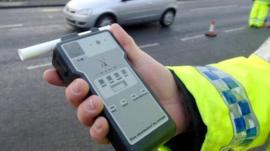 Police officer holding a breathalyser