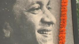 Photograph of Ravi Shankar with flower garland