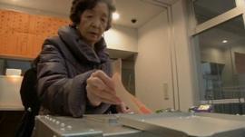 Woman voting in Japan