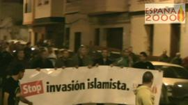 Espana2000 members hold a banner