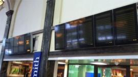 Destination boards at Cardiff Central railway station