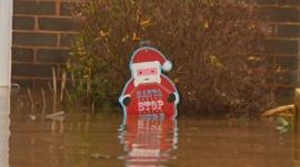 Santa decoration submerged in flood water
