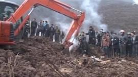 Rescuers work after the landslide