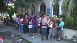 Queue outside passport office in Cuba