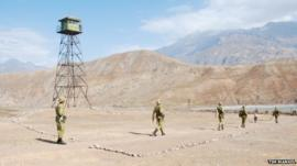 Tajik border guards set out to patrol the border with Afghanistan