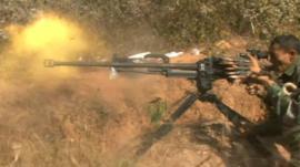 Burmese government soldier firing gun