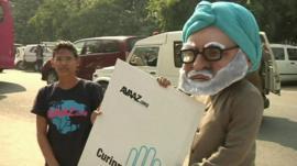 Demonstrators gather outside the court in Delhi
