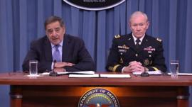 Leon Panetta and General Dempsey at a press conference 24 January 2013
