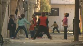 Children play in street in Homs