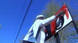 Malian painting over an Islamic Police sign