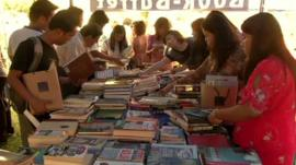 People looking at books on a table