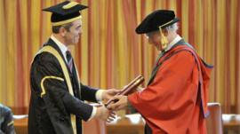 Sir Ian McKellen recieves his doctorate from university chancellor James Nesbitt
