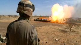 Soldier burning seized ammunition