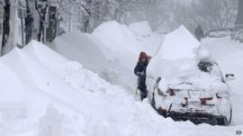 Woman shovels snow