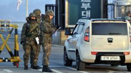 South Korean soldiers check vehicles on a road near the demilitarized zone dividing the two Koreas