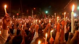 Protesters in Dhaka holding candles