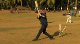 David Cameron playing cricket in India