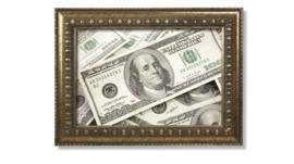 Hundred dollar bills in a brass frame