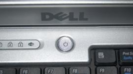 Power button and logo on Dell laptop keyboard
