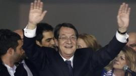 Nicos Anastasiades waves to supporters in Nicosia