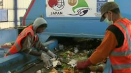 Workers sorting rubbish through in a new recycling plant