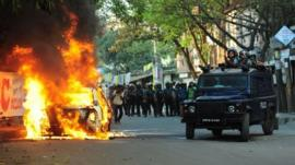 Car burns during clashes between police and activists in Dhaka. 2 March 2013