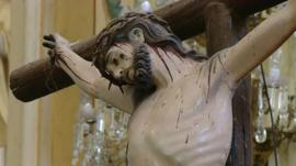 A statue of Jesus Christ on the cross in a Mexican church