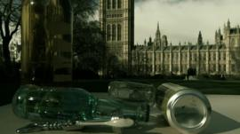 Empty bottles and cans with parliament in background