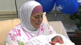Dallal with her newborn baby