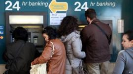 People withdraw money from ATMs in Nicosia, Cyprus. Photo: 17 March 2013
