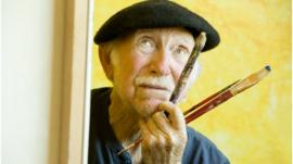 Elderly man painting
