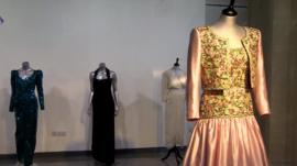 Four of Diana's dresses on display