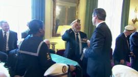 A veteran receives his medal