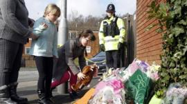 Friends of Jade Anderson lay flowers at scene of dog attack