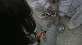 Pope Francis washing female offender's feet