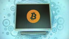 Graphic of Bitcoin logo on computer screen