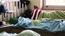 A woman lying in a post-abortion ward of a Kenyan hospital