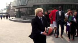 London Mayor Boris Johnson with a basketball
