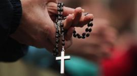 Crucifix being held in hands