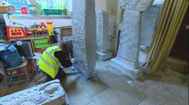 Celtic crosses being cleaned