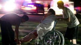 Injured elderly person assisted as a nursing home is evacuated in West. 17 April 2013
