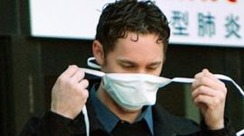 A man dons a mask in Toronto during a Sars outbreak in 2003