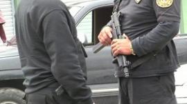 Policemen with guns